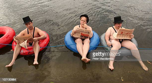 Men dressed as 'greedy businessmen' float in the Serpentine Lake in Hyde Park for a mobile phone promotion on June 16 2010 in London England Giffgaff...