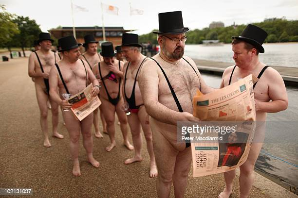Men dressed as 'greedy businessmen' wearing mankini swimming costumes stand next to the Serpentine Lake in Hyde Park for a mobile phone promotion on...