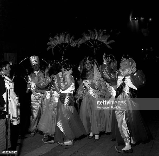 Men dressed as harem concubines parading on Carnival in Ascoli Piceno. Ascoli Piceno, 1965