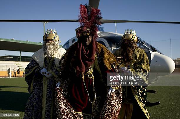 Men dressed as Kings Caspar Melchior and Balthazar otherwise known as the three wise men or Kings arrive in helicopter to take part in an Epiphany...