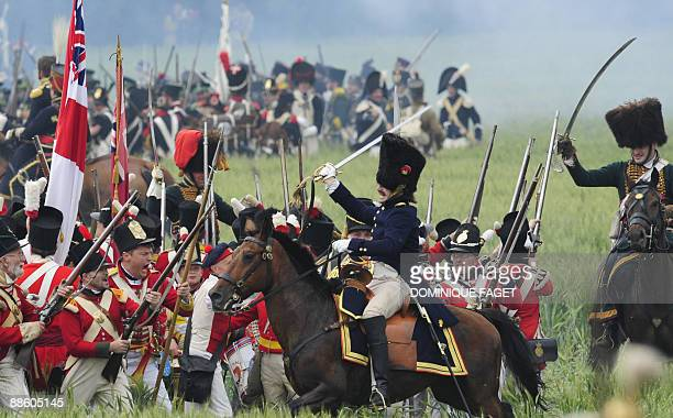 Men dressed as soldiers fight in a reeanactment of the battle of Waterloo on June 21 2009 with some 1200 others history enthusiasts from 20 European...