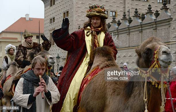 Men dressed as the Three Kings ride camels as they take part in a procession featuring the kings' journey to the Christ child born in Bethlehem on...