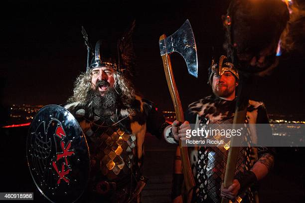 Men dressed as Vikings take part in the torchlight procession as it makes its way through Edinburgh for the start of the Hogmanay celebrations on...
