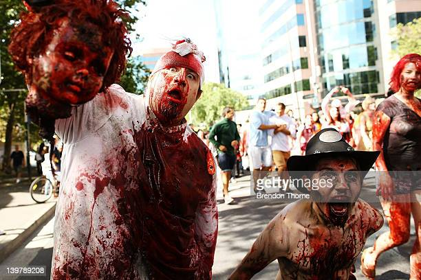 Men dressed as zombies walk the streets of Sydney on February 25 2012 in Sydney Australia The annual Zombie Walk raises money for the Brain...