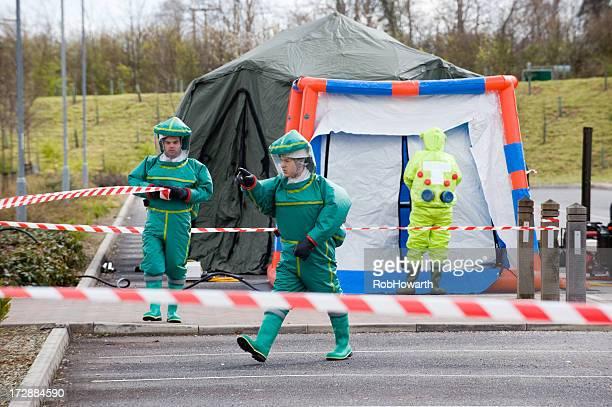 Men dressed in biological hazard suits in quarantine