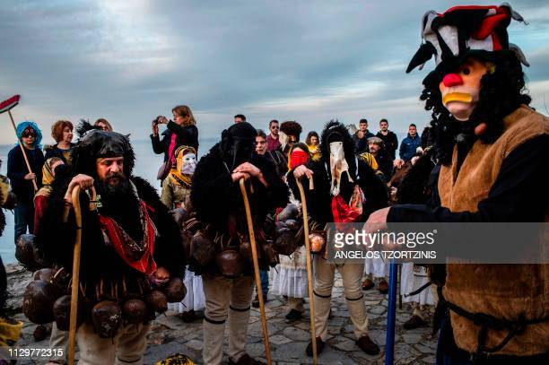 Men dressed in costumes of ''Old man'' take part in the Skyrian Carnival on the island of Skyros northeast of Athens on March 9 2019 In the...