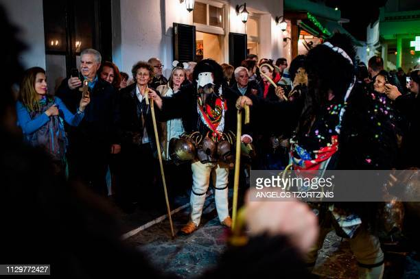 Men dressed in costumes of ''Old man'' take part in the Skyrian Carnival on the island of Skyros northeast of Athens on March 10 2019 In the...