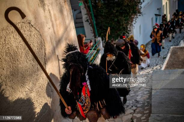 Men dressed in costumes of ''Old man'' takes part in the Skyrian Carnival on the island of Skyros northeast of Athens on March 9 2019 In the...