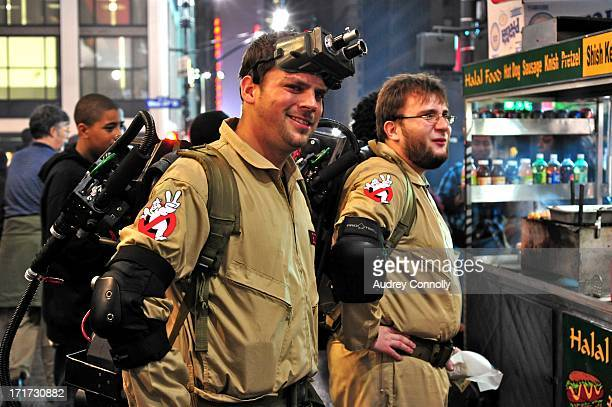 Men dressed in ghostbusters costumes, New York City on Halloween at a food cart