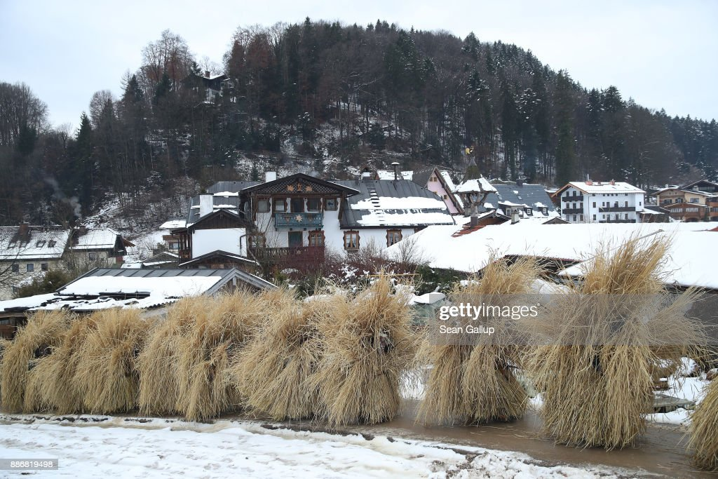 Men dressed in masks and straw in the form of a figure known locally as 'Buttnmandl', or 'Shaking Man', ascend on the outskirts of town to a meadow in an annual tradition on December 5, 2017 in Berchtesgaden, Germany. Buttnmandl wears heavy cowbells that he rings by shaking his hips. His role is to drive away the evils spirits of winter and awaken slumbering Mother Nature. He also accompanies Saint Nicholas and goes house to house, visiting families as Saint Nicholas hears which children have been good and which have been bad. Buttnmandl is specific to the Berchtesgadener Land region of southeastern Bavaria but is similar in intent to the more common Krampus, the fur-clad figure with a terrifying mask that has, especially in recent decades, become an intrinsic part of local folklore throughout late November and most of December in the alpine regions of Germany, Austria and Italy.