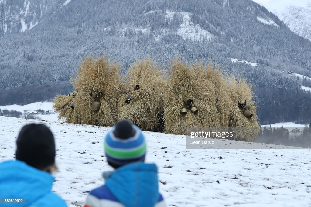 Men dressed in masks and straw in the form of a figure known locally as 'Buttnmandl', or 'Shaking Man', gather on a meadow above the town in an annual tradition on December 5, 2017 in Berchtesgaden, Germany. Buttnmandl wears heavy cowbells that he rings by shaking his hips. His role is to drive away the evils spirits of winter and awaken slumbering Mother Nature. He also accompanies Saint Nicholas and goes house to house, visiting families as Saint Nicholas hears which children have been good and which have been bad. Buttnmandl is specific to the Berchtesgadener Land region of southeastern Bavaria but is similar in intent to the more common Krampus, the fur-clad figure with a terrifying mask that has, especially in recent decades, become an intrinsic part of local folklore throughout late November and most of December in the alpine regions of Germany, Austria and Italy.