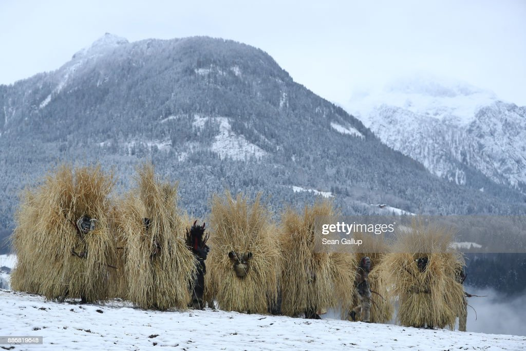 Men dressed in masks and straw in the form of a figure known locally as 'Buttnmandl', or 'Shaking Man', descend accompanied by a creature called a Krampus after gathering on a meadow above the town in an annual tradition on December 5, 2017 in Berchtesgaden, Germany. Buttnmandl wears heavy cowbells that he rings by shaking his hips. His role is to drive away the evils spirits of winter and awaken slumbering Mother Nature. He also accompanies Saint Nicholas and goes house to house, visiting families as Saint Nicholas hears which children have been good and which have been bad. Buttnmandl is specific to the Berchtesgadener Land region of southeastern Bavaria but is similar in intent to the more common Krampus, the fur-clad figure with a terrifying mask that has, especially in recent decades, become an intrinsic part of local folklore throughout late November and most of December in the alpine regions of Germany, Austria and Italy.