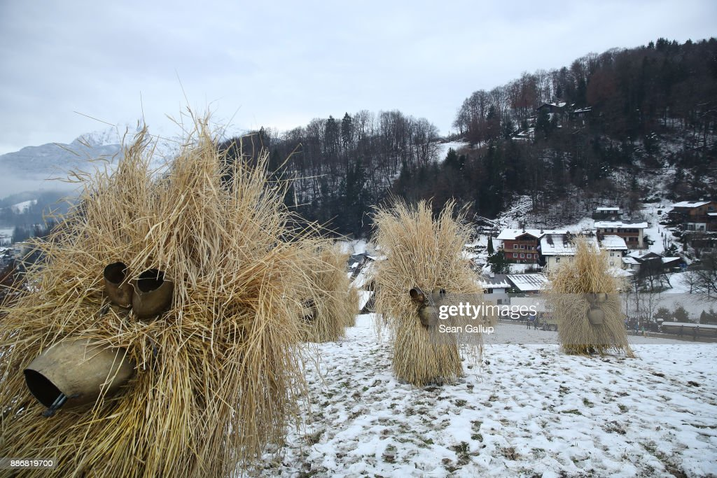 Men dressed in masks and straw in the form of a figure known locally as 'Buttnmandl', or 'Shaking Man', descend wearing cow bells on their backs after gathering on a meadow above the town in an annual tradition on December 5, 2017 in Berchtesgaden, Germany. Buttnmandl wears heavy cowbells that he rings by shaking his hips. His role is to drive away the evils spirits of winter and awaken slumbering Mother Nature. He also accompanies Saint Nicholas and goes house to house, visiting families as Saint Nicholas hears which children have been good and which have been bad. Buttnmandl is specific to the Berchtesgadener Land region of southeastern Bavaria but is similar in intent to the more common Krampus, the fur-clad figure with a terrifying mask that has, especially in recent decades, become an intrinsic part of local folklore throughout late November and most of December in the alpine regions of Germany, Austria and Italy.