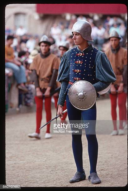 Men dressed in medieval costume participates in the annual celebrations surrounding the Corsa del Palio horse race, held in Siena's main square.