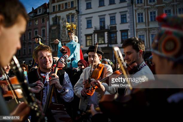 Men dressed in Moravian costume play musical instruments as they celebrate the opening of the Carnevale Praga 2015 festival as part of Prague...