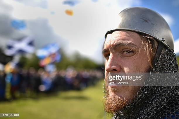 Men dressed in period costume attend a ceremony at the Stirling Bridge Battle Site as the Saltire was raised for the first time in 700 years on May...