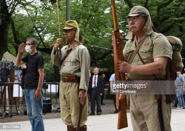 Men dressed in period Japanese Imperial Army uniform visit the controversial Yasukuni shrine on the 72nd anniversary of Japan's surrender in World...