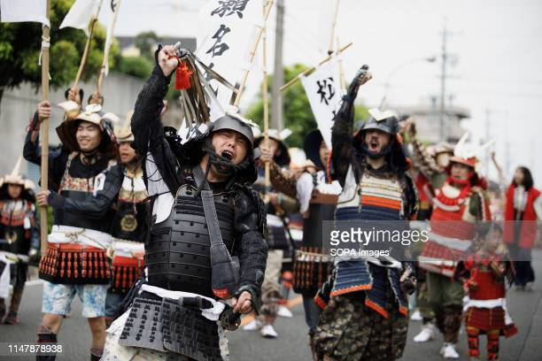 Men dressed in samurai warrior armour chants slogans during the Okehazama Historical Battlefield Festival in Aichi toyoake In 1560 Oda Nobunaga and...