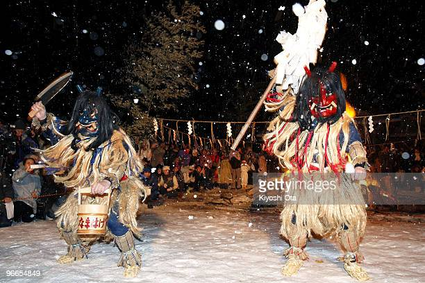 Men dressed in straw clothes and orge masks as Namahage or mountain demons perform dances during the Namahage Sedo Festival at Shinzan Shrine on...