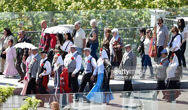 Men dressed in traditional attire chulapo and women in tradiional garb parade during the San Isidro celebration marking Madrid's patron saint San...