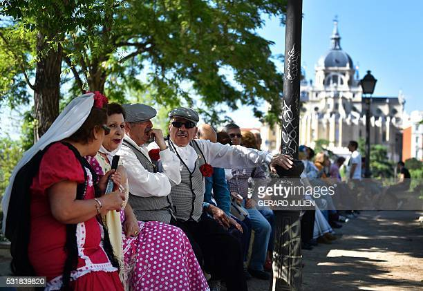 Men dressed in traditional attire 'chulapo' take part in the San Isidro celebration marking Madrid's patron saint San Isidro's day in Madrid on May...