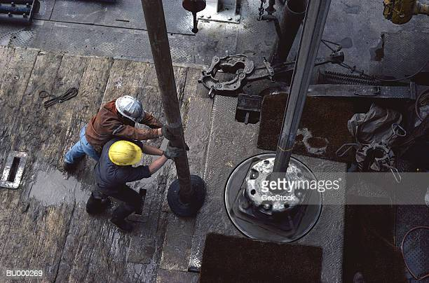 Men Drilling for Oil on an Oil Rig