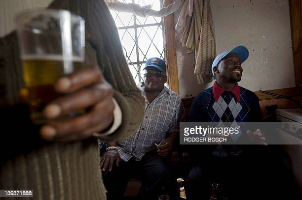 Men drink in a shebeen an illegal tavern usually in someone's home in Gugulethu on February 10 about 15Km from the centre of Cape Town The widespread...