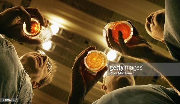 Men drink pints of beer at the Great British Beer Festival on August 1, 2006 in London. The Great British Beer Festival runs from August 1-5, 2006 at...