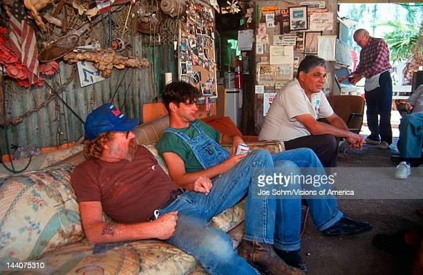Men drinking beer and relaxing, VA Key, Miami, FL