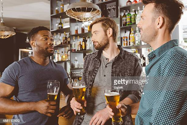 Men drinking beer in a pub