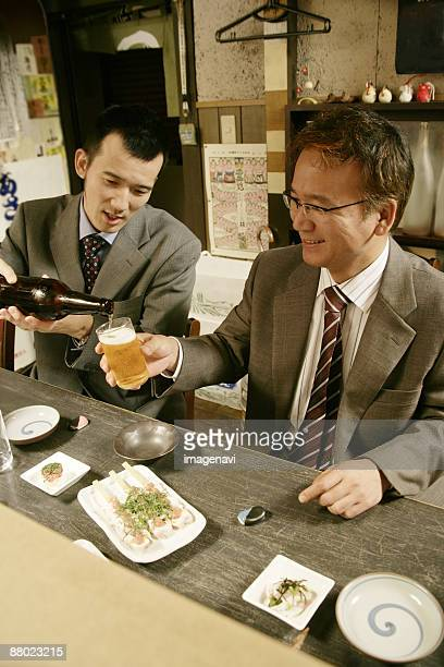 Men drinking beer in the Japanese-style pub