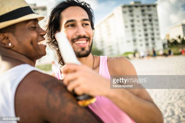 men drinking beers at the party beach in Miami