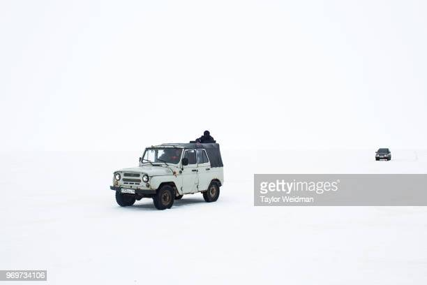 Men drive 4WD vehicles on the frozen surface of the Aral Sea near Tastubek Kazakhstan The Aral Sea once the fourthlargest lake in the world started...