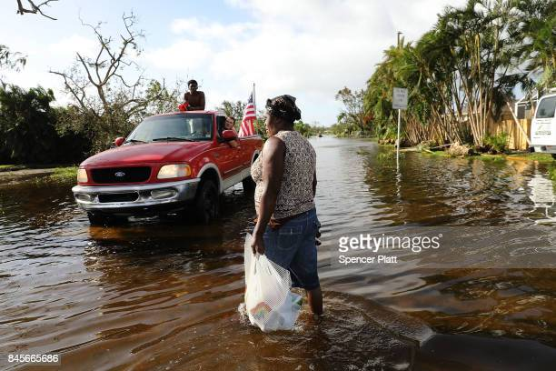 Men drive through the flooded streets looking to see if people need help the morning after Hurricane Irma swept through the area on September 11 2017...