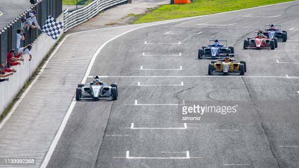 men driving formula racing cars - car racing stock pictures, royalty-free photos & images