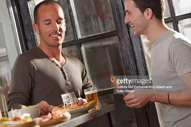 Men eating together in tapas bar