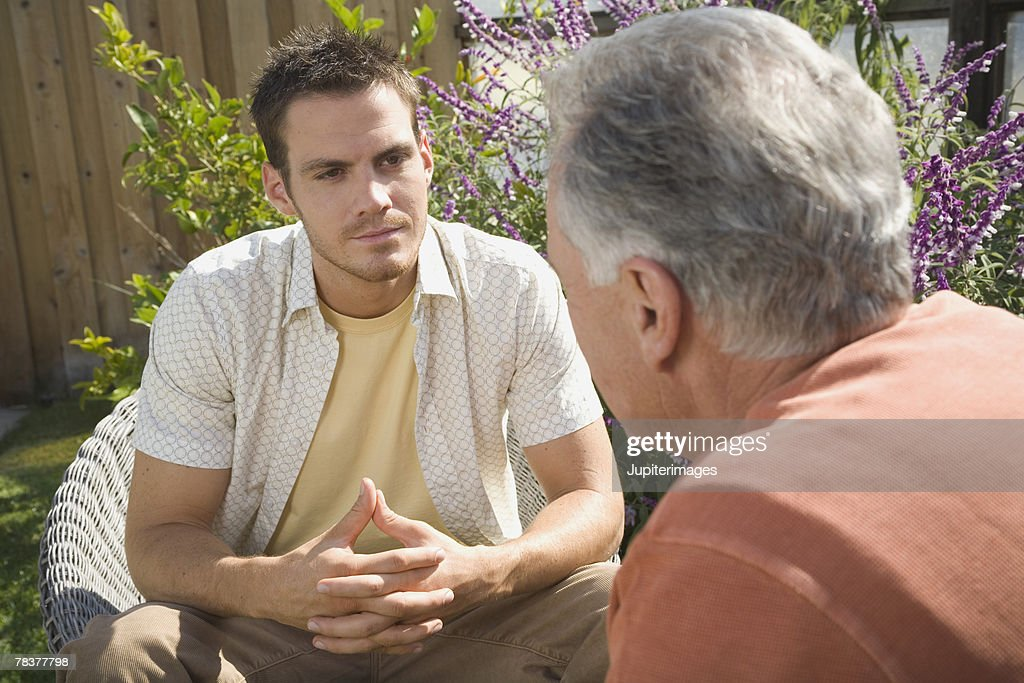 Men engaged in conversation : Stock Photo
