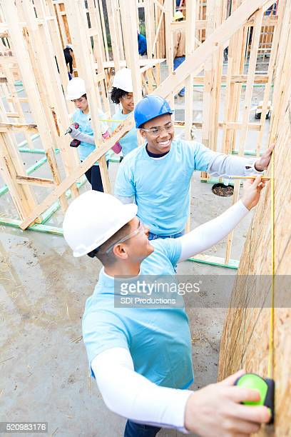 Men enjoy working on charity home