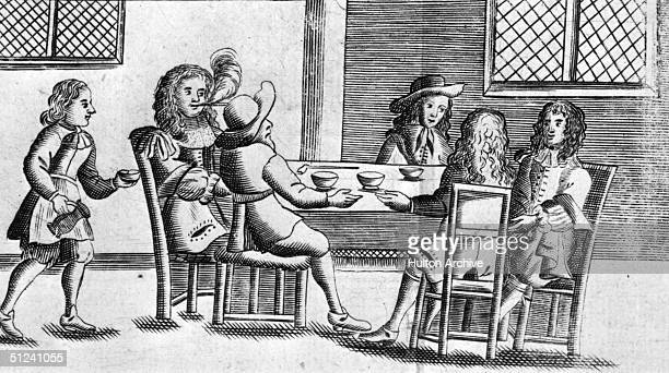 1674 Men enjoying a drink and a chat in a 17th century coffee shop