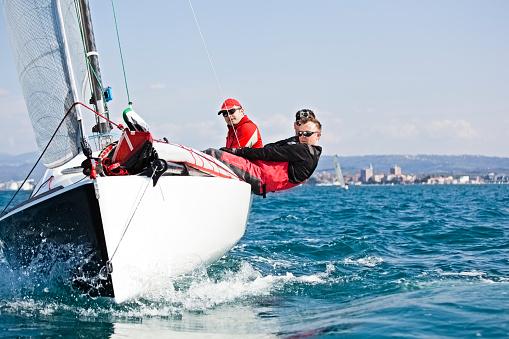 Men enjoying the sport of sailing 153041385