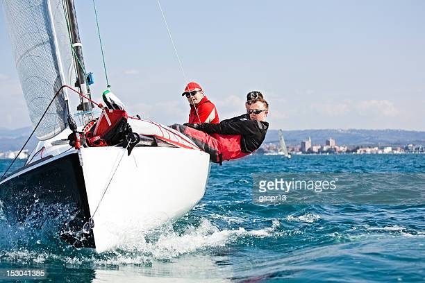 men enjoying the sport of sailing - sailing team stock pictures, royalty-free photos & images