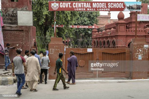 Men enter a school campus which is functioning as a polling station in Lahore Pakistan on Wednesday July 25 2018 Pakistanis are voting today in a...