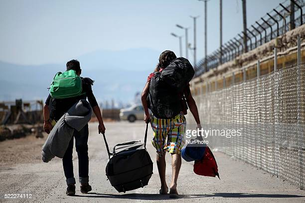 Men entering the camp Refugee camp in Skaramaga area a port town 11 km west of Athens A large camp is being constructed here with a big capacity and...