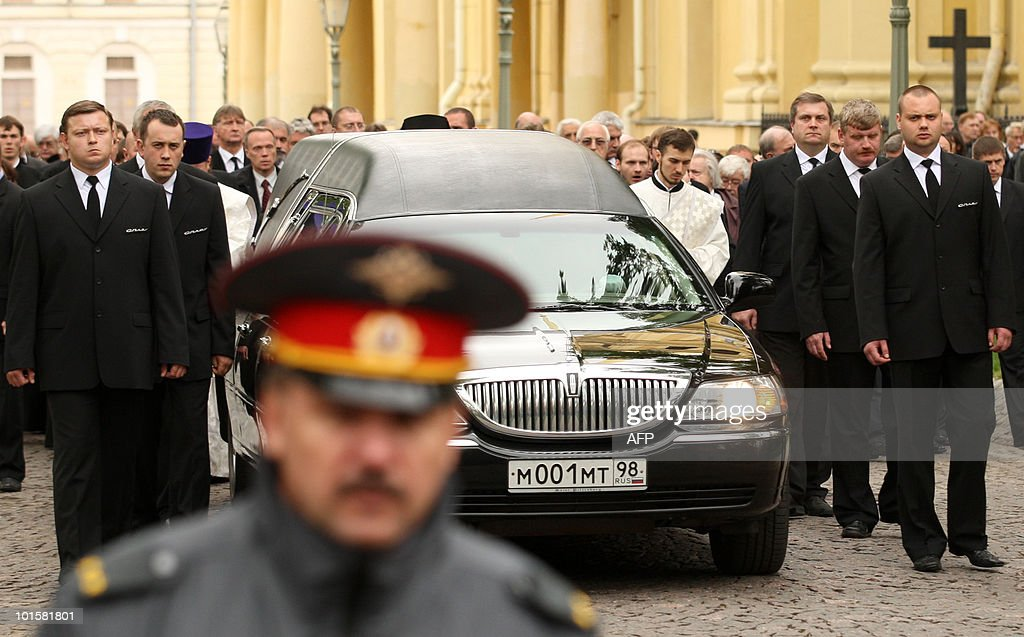 Men escort a hearse with the coffin of Grand Duchess Leonida Georgievna of the Romanov dynasty in St. Petersburg on June 3, 2010 during her funeral at the Peter and Paul Cathedral. Grand Duchess Leonida Georgievna, a senior member of Russia's Romanov dynasty, died on May 23, 2010 aged 95 after a life that saw her marry a US industrialist and then the claimant to the Russian throne. Born in 1914 before the Russian Revolution that ousted the Romanov imperial family, she had been the last surviving member of the dynasty to be born in the Russian Empire, a spokesman for the family said.