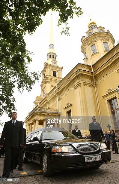Men escort a hearse with the coffin of Grand Duchess Leonida Georgievna of the Romanov dynasty in St Petersburg on June 3 2010 during her funeral at...