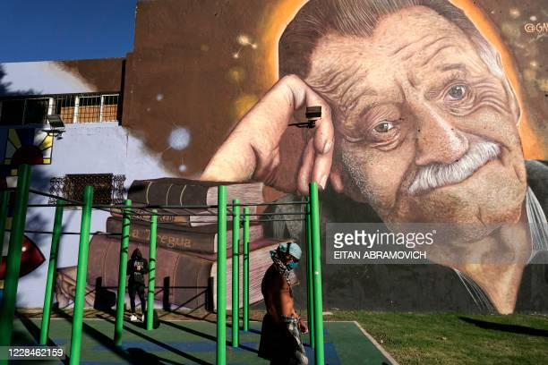 Men excercise in front of a mural by street artist Jose Gallino, depicting Uruguayan writer Mario Benedetti, at Plaza Zelmar Michellini, mentioned in...