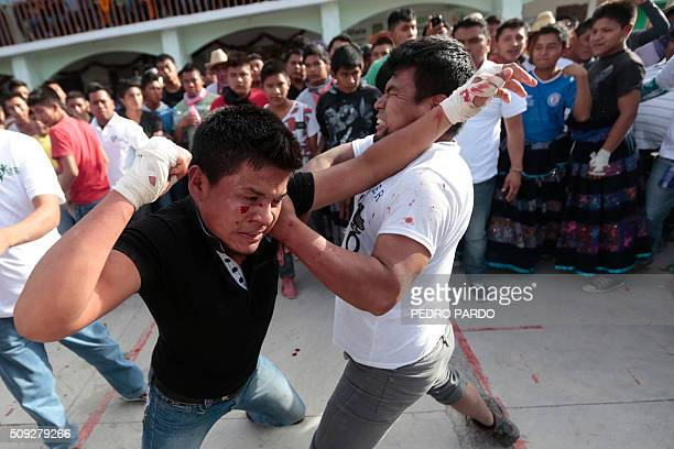 Men exchange punches a feature of the Xochimilcas fight to defend their women against the Aztecs in the Mexican municipality of Zitlala in Guerrero...