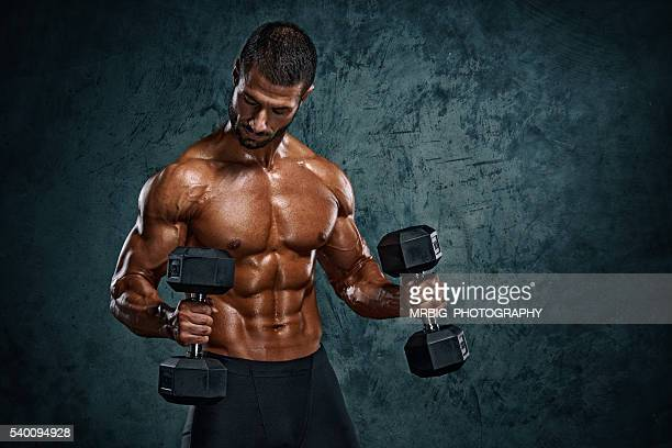 Men Exercise With Dumbbells
