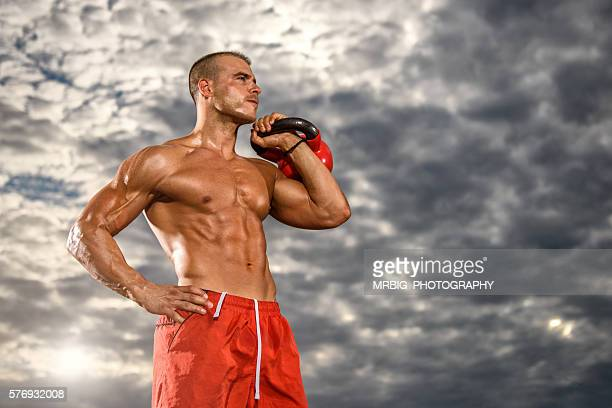 Men Exercise With Kettle Bell