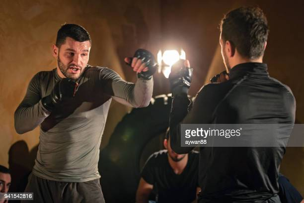 men exercising kickboxing at the gym - muay thai stock pictures, royalty-free photos & images